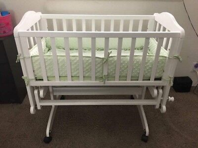 Dream On Me Lullaby Cradle Glider in White Transitional Baby Cradle with Bedding