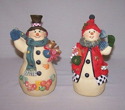 Happy Couple Of A Snowman And Snowlady With Bells And Candy Canes