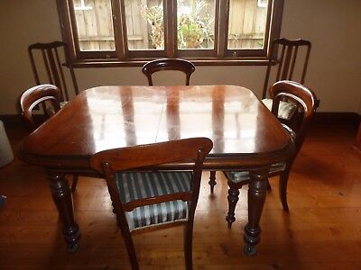 antique rosewood dining table and 6 matching chairs