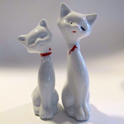 A pair of Small White Ceramic Long Necked Cats Unmarked Mid Century Kitsch