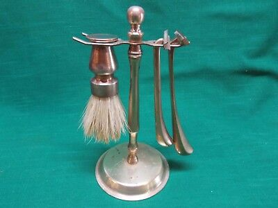 Vintage brass shaving stand with brush and 2 razors. Some tarnish.