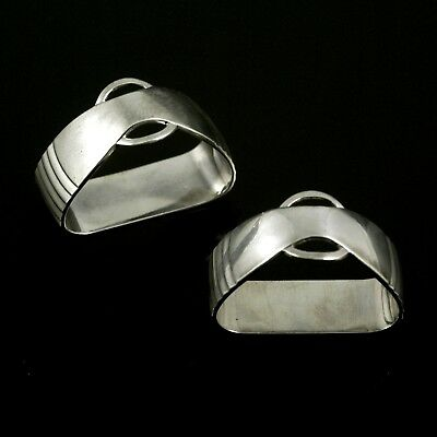 Georg Jensen. A Pair of Sterling Silver Napkin Rings - Parallel / Relief  #155