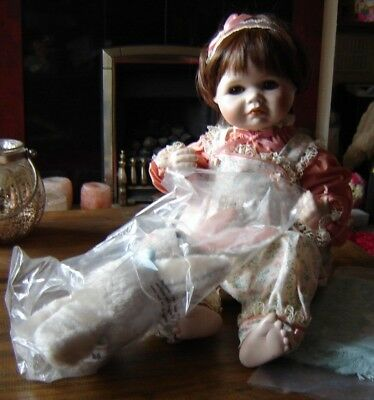 "Sara porcelain doll by The Hamilton Collection complete in box. Approx 18"" long."