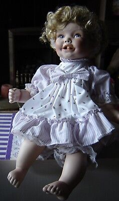 "Sydney porcelain doll by The Hamilton Collection complete in box. 16.5"" long."