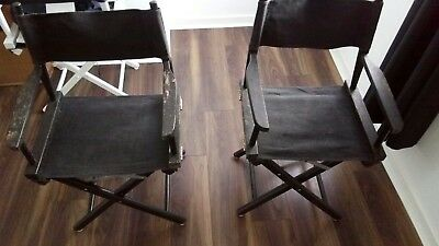 Two used black director's chairs