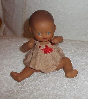 Lovely little antique baby doll, ceramics or terracotta,all original