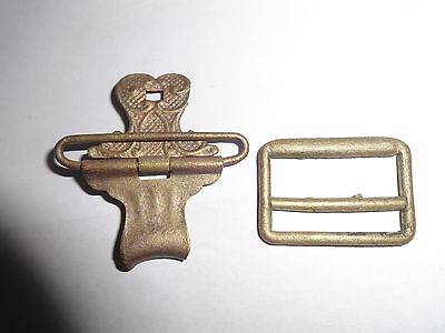 Two old suspender clips