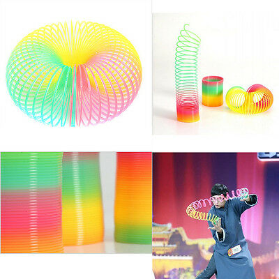 1Pcs Magic Slinky Plastic Rainbow Springs Bounce Children Toy Birthday Gift FT