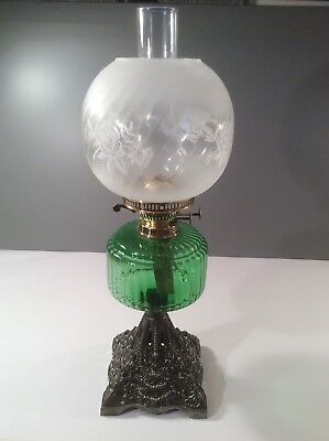 VICTORIAN CAST IRON AND GREEN GLASS OIL LAMP. F.S. & Co