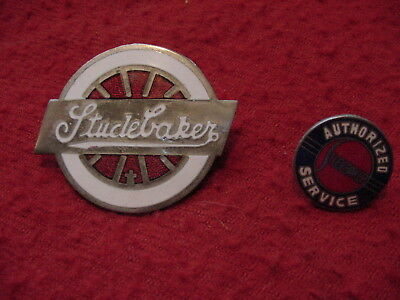 2 old enamel Studebaker advertising pins. Authorized Service and Spoked Wheel