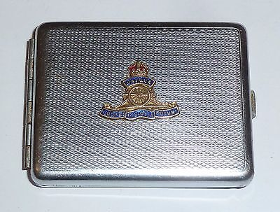 A VINTAGE 1930s CHROME PLATED MATCH BOOK HOLDER WITH ROYAL ARTILLERY PLAQUE