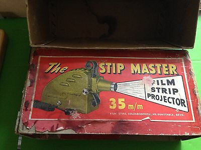 Stip Master film projector (boxed) and Photax table screen (also boxed)