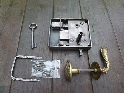 Vintage / antique metal door lock with one key, brass handle and knob, project.
