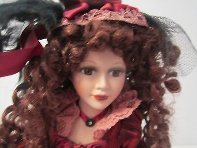 Porcelain Doll fully clothed with stand Collectors Choice