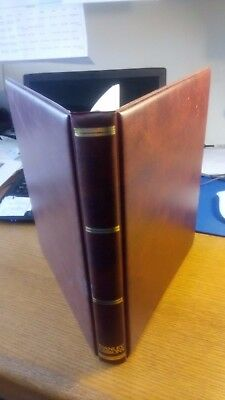 Stanley Gibbons album. Brown, gold lettering plus 35 Sarum album leaves 22 ring