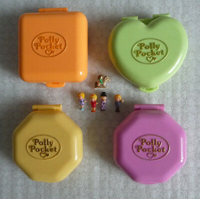 Collection of Four Polly Pocket Compact Play Sets
