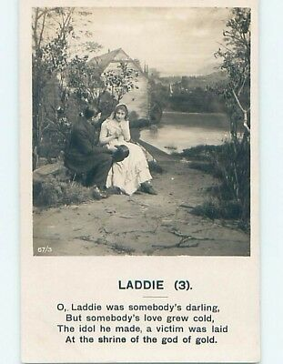 Bamforth rppc COUPLE SITTING TOGETHER BY THE WATER HL9321