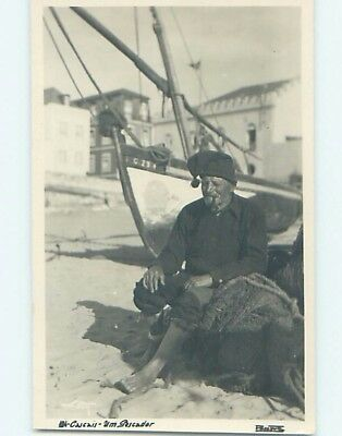 old rppc MAN SITTING BESIDE BOAT Cascais Portugal HM1396