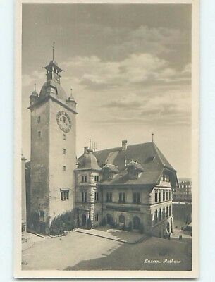 old rppc CLOCK TOWER BESIDE BUILDING Lucerne - Luzern Switzerland HM1517
