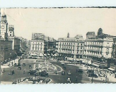 old rppc OLD CARS BY SHOPS ALONG STREET Madrid Spain HM1944