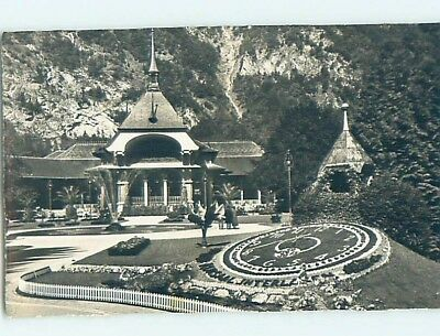old rppc FLORAL CLOCK AND BUILDING Interlaken Switzerland HM1815