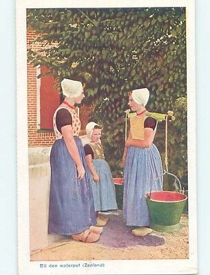 W-Border GIRL CARRYING WATER PALES Zeeland Netherlands hn6437