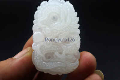 Chinese natural white jade soft jade carvings of the zodiac dragon pendant