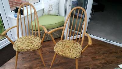 A Pair of Ercol Windsor High Back Carver Chairs