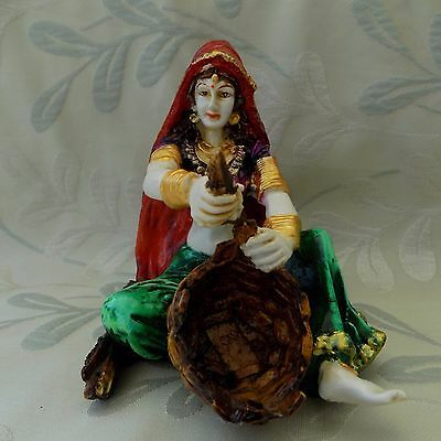 Indian basket maker figurine
