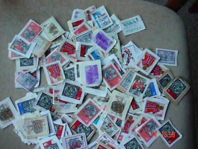 140 Mixed used UK CHRISTMAS stamps most years 1970(or earlier) to 1984 on paper.