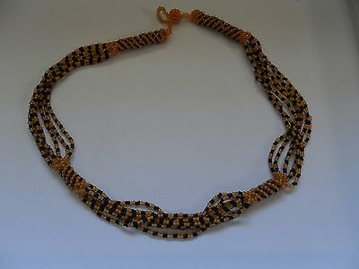 Zulu seed bead necklace handmade in South Africa - gold/black