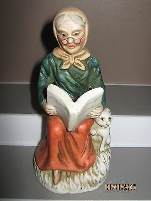Ceramic figurine no8 old woman sitting reading book 140 to 180 mm ex/cond