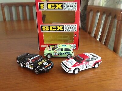 3x SCX (Scalextric) boxed used rally cars.