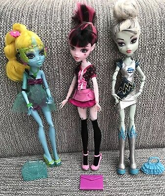 Monster High Dolls Bundle Frankie Stein, Draculara & Lagoona Blue with Handbags