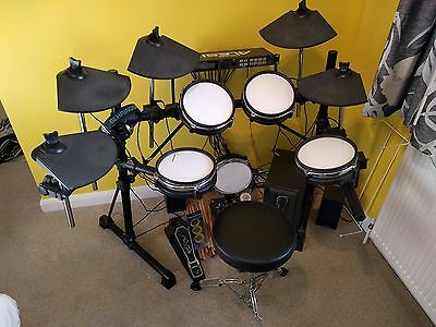 Alesis DM5 Electric drum kit with AMP