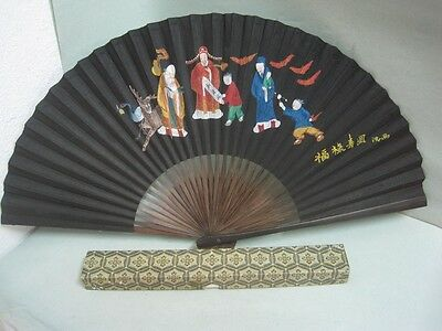 Antique chinese fan in wood and paper with mans Written on the back