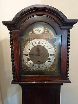 Grandmother Clock Lovely Westminster chimes.  Hand wind-up movement