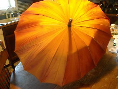 Vintage peachy rust umbrella with green alligator handle tip and loop