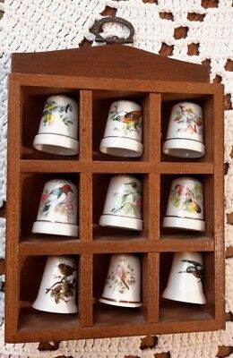 small set of thimbles in wooden display bird species china