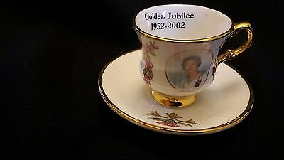 Miniature china cup and saucer commemorating the Queen's Golden Jubilee in 2002