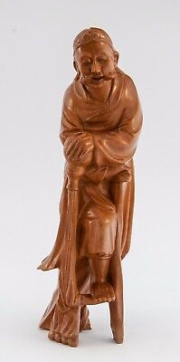 Chinese Wooden Carving of Man Posing one leg raised on a stool.