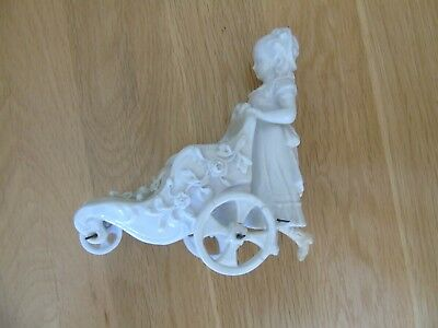 White Porcelain Model of A Girl Pushing a Pram