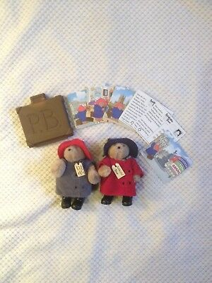2 small jointed Paddington Bear toys with suitcase and postcards