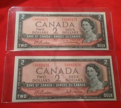 Lot of 2 Canadian 2 dollar bills 1954 consecutive serial numbers AU to UNC