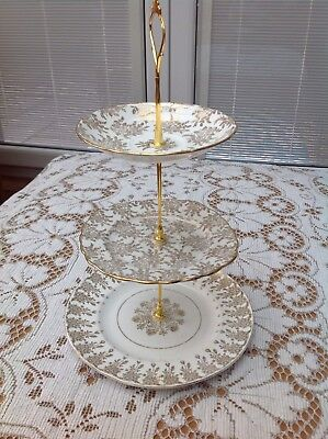 Vintage Three Tier Cake Stand In White & Gold. All Matching Plates