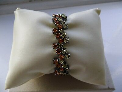 Beautiful 1950s chrome cuff with prong-set amber and clear stones