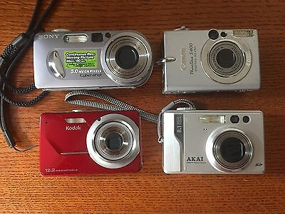 4 Digital Cameras Untested AS IS     I don't have the Power Cords to Test Them