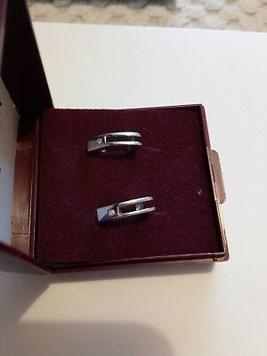 * Pair Of Sterling Silver And Real Diamond Earrings