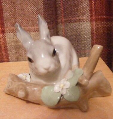 Lladro  Rabbit Looking Over A Tree Trunk With Flower