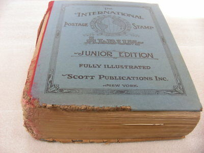 WW, BRITISH COLONIES, 4000+ Stamps hinged in a 1945 Scott International Jr